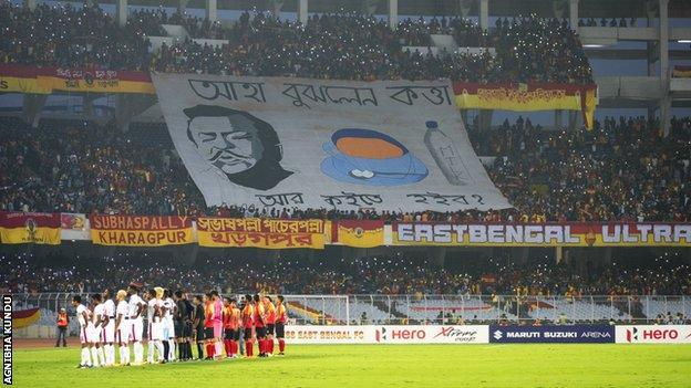 Fans hold aloft their 'Tifo'
