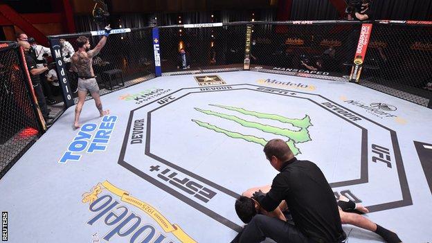 Cody Garbrandt celebrates after his knockout victory over Raphael Assuncao