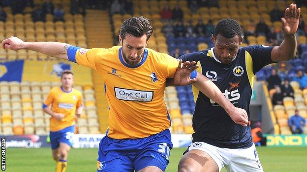 Krystian Pearce (right) in action against Mansfield Town's Ollie Palmer