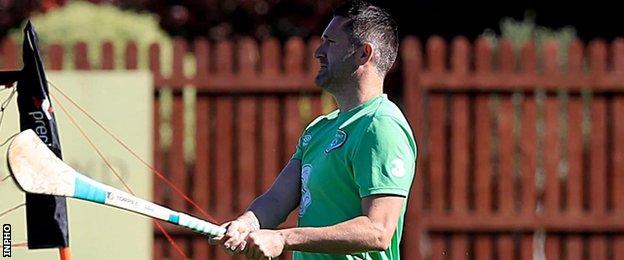 Robbie Keane swings a hurley at Republic training on Thursday morning