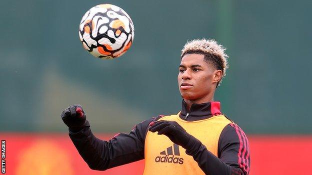 Rashford back in training with United