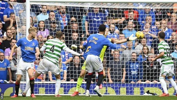 Rangers' Filip Helander beats Celtic's Joe Hart with a header