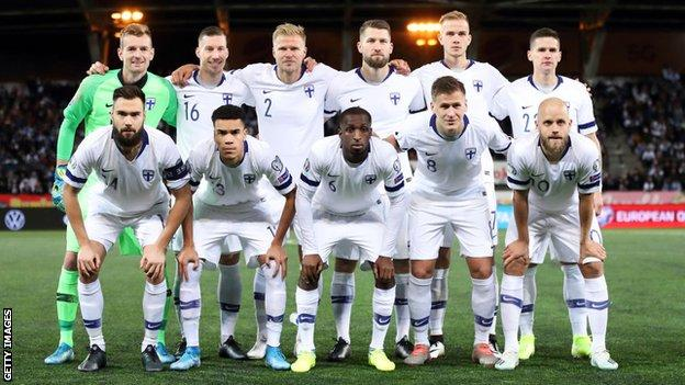 Finland's squad line up for a photo before the game with Lichtenstein in 2019