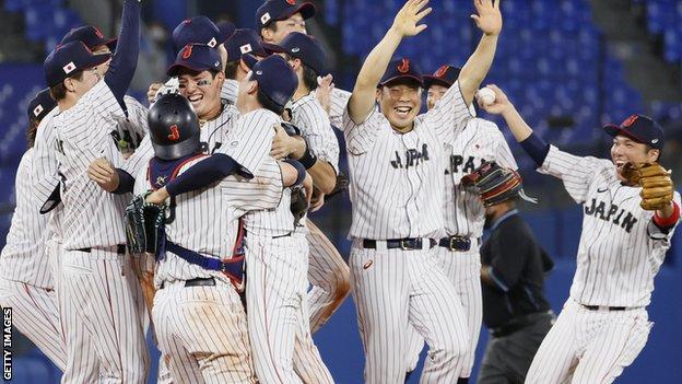 Japan's baseball team celebrate winning gold in men's baseball