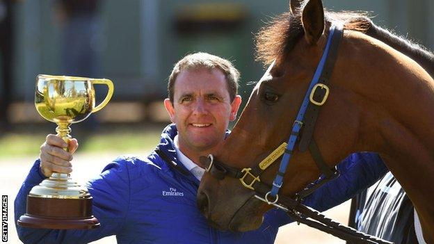 Cross Counter's trainer Charlie Appleby with the Melbourne Cup