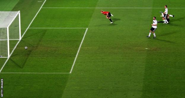 Fernando Torres scores against Germany in the Euro 2008 final