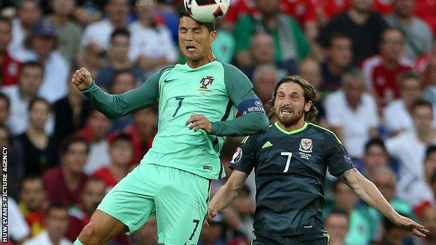Portugal's Cristiano Ronaldo and Wales' Joe Allen compete at the Euro 2016 semi-finals