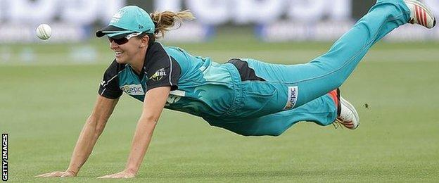 Kate Cross dives for the ball during a Women's Big Bash League game