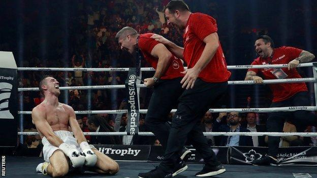 Smith's brothers and trainer Joe Gallagher rushed to join him in the ring when the stoppage arrived
