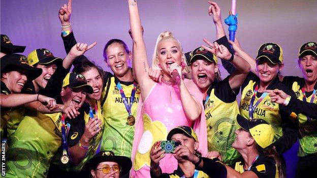 The Australia team joins Katy Perry on stage after the final