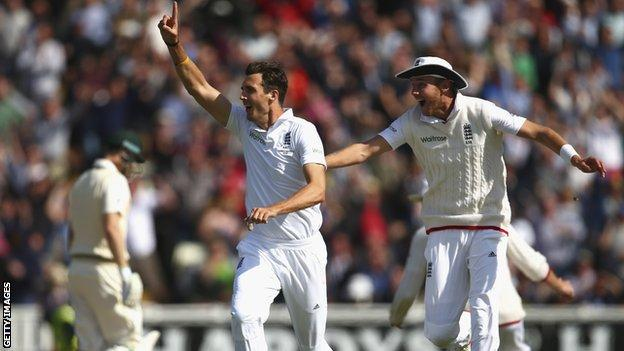Steven Finn celebrates a wicket with Stuart Broad