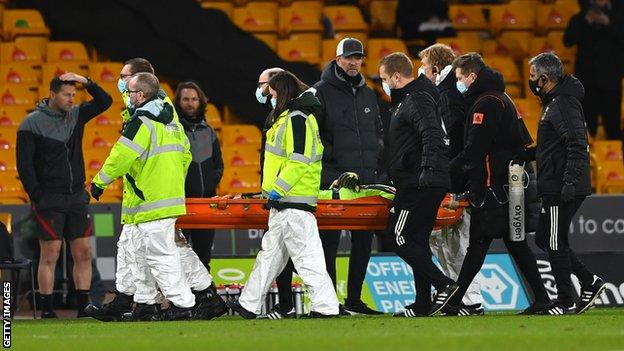 Wolves keeper Rui Patricio is carried off on a stretcher after sustaining a head injury against Liverpool