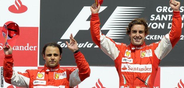 Felipe Massa and Fernando Alonso on the podium during the German Grand Prix 2010