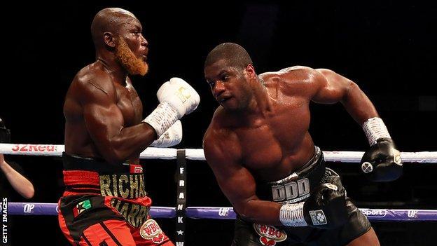 British heavyweight Daniel Dubois (right) lands a blow against Ghana's Richard Lartey (left)