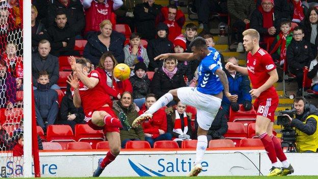 Rangers' Alfredo Morelos sees his shot blocked by Andrew Considine of Aberdeen