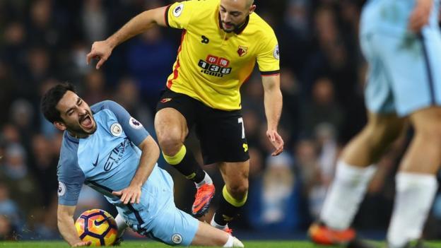 Ilkay Gundogan of Manchester City is fouled by Nordin Amrabat of Watford