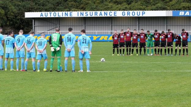 Warrenpoint Town and Coleraine observe a minute's silence, which was held at most Irish Premiership games as a mark of respect following the Paris attacks