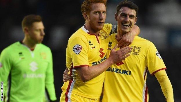 MK Dons celebrate scoring against Derby