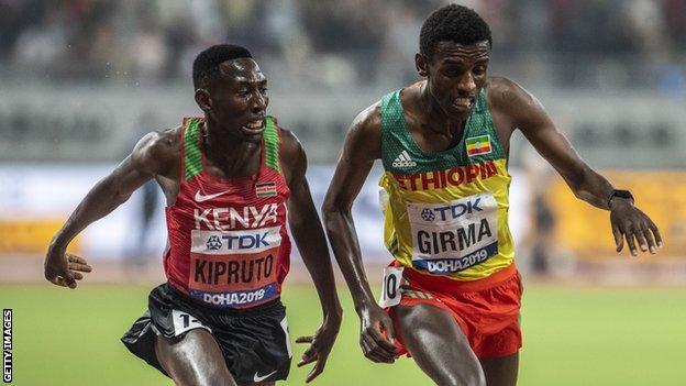 Kenya's Conseslus Kipruto (left) beats Ethiopia's Lamecha Girma (right) in a thrilling photo finish to win 3,000m steeplechase gold at the 2019 Doha World Championships