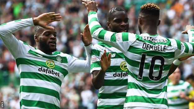 Moussa Dembele (right) celebrates his first goal