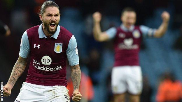 Henri Lansbury celebrates Aston Villa scoring against Derby