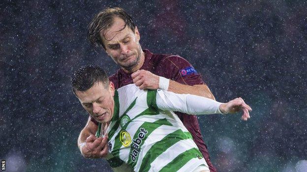 Celtic's Callum McGregor holds off Cluj's Damjan Djokovic