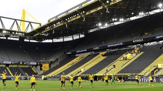 The Dortmund players saluted the empty stands at the final whistle