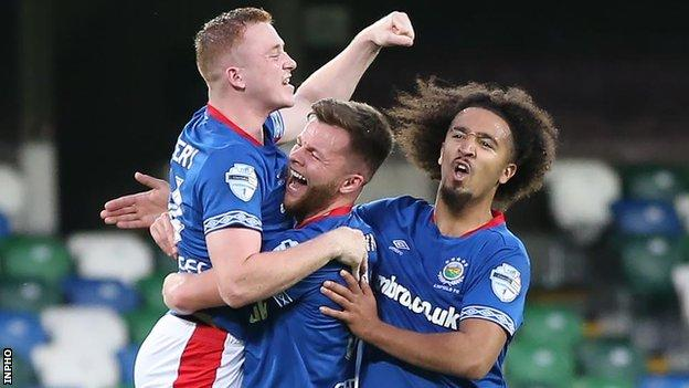 Shayne Lavery (left) celebrates one of his goals with Niall Quinn and Bastien Hery