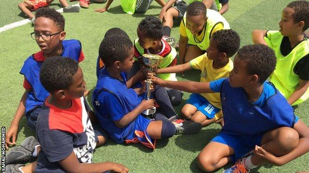 Children with a trophy at the Somaliland Football Academy