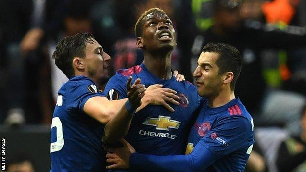 Paul Pogba (centre) celebrates with team-mates