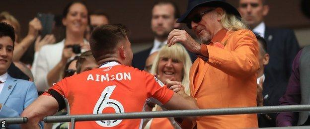 Blackpool's Will Aimson shakes hands with Owner Owen Oyston after the final whistle