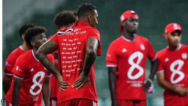 Bayern Munich's players wore red T-shirts after full-time with the number eight on them to mark the club winning the Bundesliga between 2013 and 2020