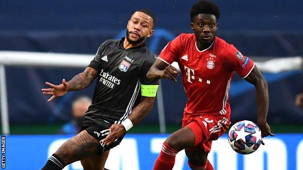 Alphonso Davies (right) in action for Bayern against Lyon
