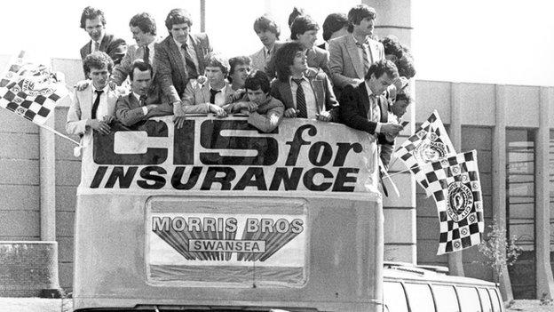 Swansea's players and staff celebrated their promotion to Division One with an open-top bus parade