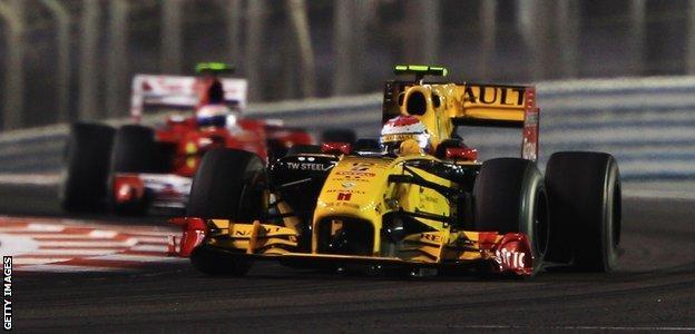 Renault's Vitaly Petrov and Ferrari's Fernando Alonso