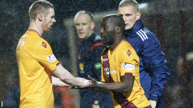 Stephen Pearson (left) is replaced by Morgan Gomis in Motherwell's win over Dundee United on Friday