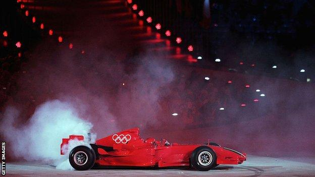F1 car with the Olympic rings