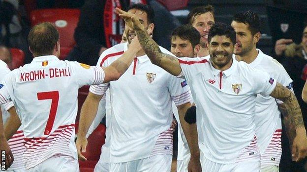 Sevilla players celebrate