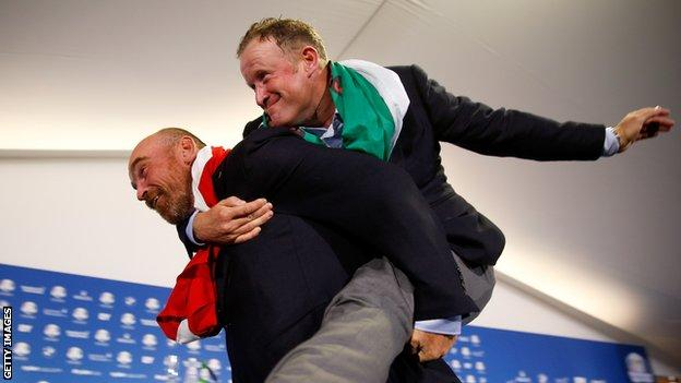 Jamie Donaldson jumps on the back of Thomas Bjorn after Europe's win in the 2014 Ryder Cup