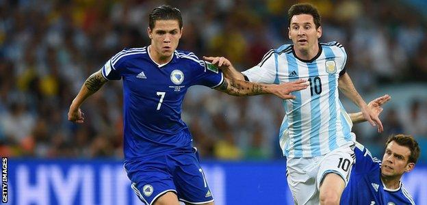 Lionel Messi of Argentina takes on Muhamed Besic of Bosnia and Herzegovina at the 2014 World Cup