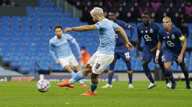 Aguero scores City's equaliser from the penalty spot against Porto on Wednesday night