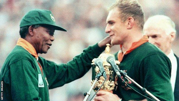 The image of Mandela handing the Rugby World Cup to Pienaar - an iconic image of South African sport