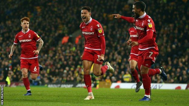 Matty Cash (centre) celebrates his first-half goal against Norwich