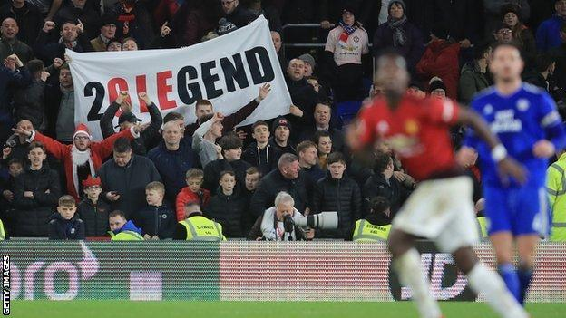 Ole Gunnar Solskjaer banner, with Paul Pogba in the foreground