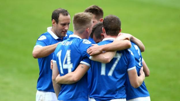 Linfield players gather to congratulate hat-trick hero Andrew Waterworth after he scored the second of his three goals against Dungannon Swifts