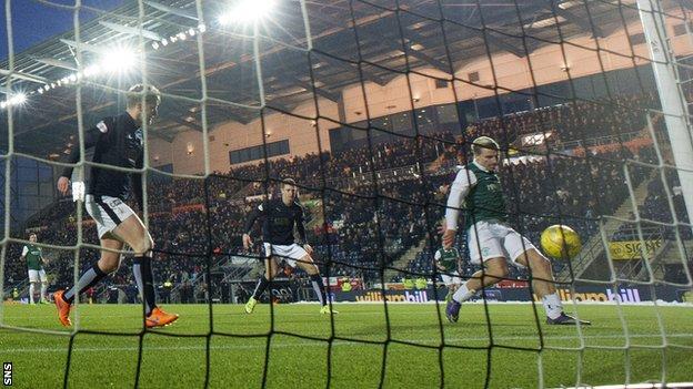 Jason Cummings scores for Hibernian against Falkirk