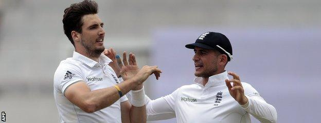 Steven Finn celebrates a wicket with Alex Hales