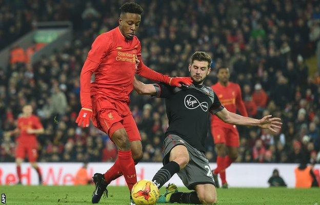 Divock Origi went down under the challenge of Jack Stephens late on but referee Ben Atkinson gave no penalty