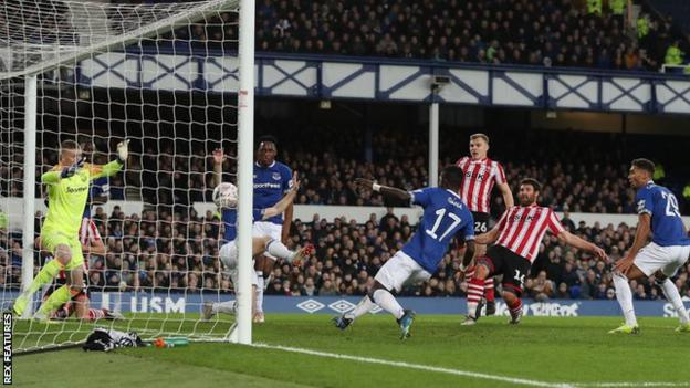 Michael Bostwick scores for Lincoln City against Everton