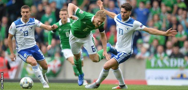 Northern Ireland felt they should have had an early penalty for Ervin Zukanovic's challenge on George Saville